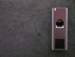 closeup of grey stone entrance door with security fingerprint scanner lock