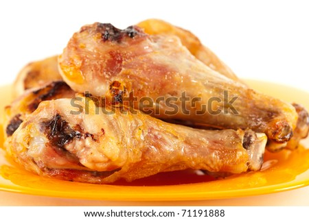 Closeup of grilled chicken drumsticks isolated on white background