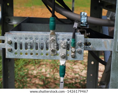 Closeup of ground bar panels with cables and connectors Prevent electric shock in case of electrical leakage from electrical appliances and make electronic devices work perfectly.