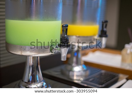 Closeup of Guava and Orange juice in water cooler for guess of seminar in the hotel