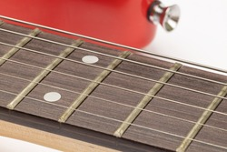 Closeup of Guitar Frets and metal Strings.