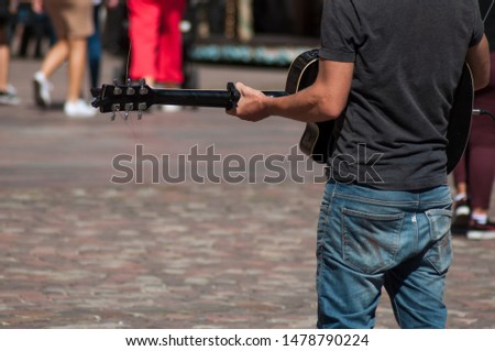Closeup of guitarist playing on cobbles place in Mulhouse