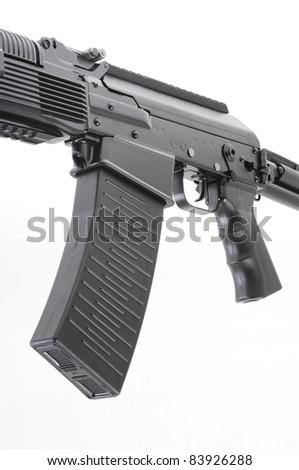Closeup of gun isolated on white background - stock photo