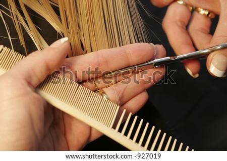 closeup of hairdresser cutting hair
