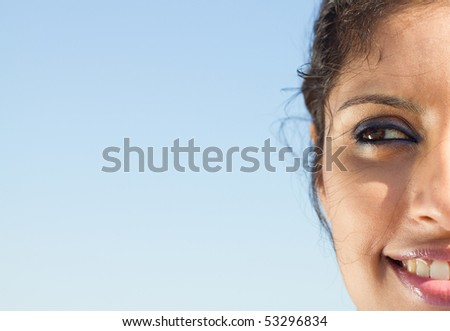 Closeup of half face of young fresh woman
