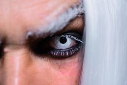 Closeup of halloween makeup. Horror. Halloween make up. Scary concept. 31 october. Halloween man with dark makeup. Devil.