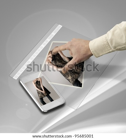 closeup of hand touching screen on futuristic tablet