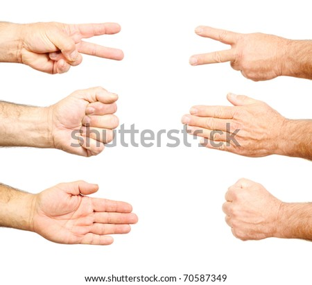 Closeup of hands making:  Rock, paper, scissors isolated on white
