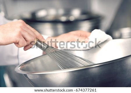 Closeup of hands mixing ingredients in a bowl