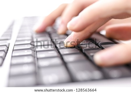 Closeup of  hands typing on computer keyboard. With shallow depth of field.