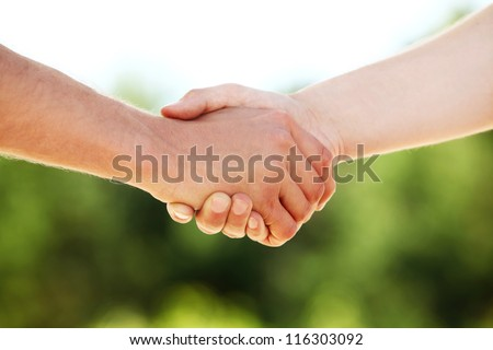 Closeup of Handshake with nature background