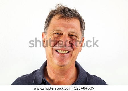 Closeup of handsome smiling man in black leisure shirt