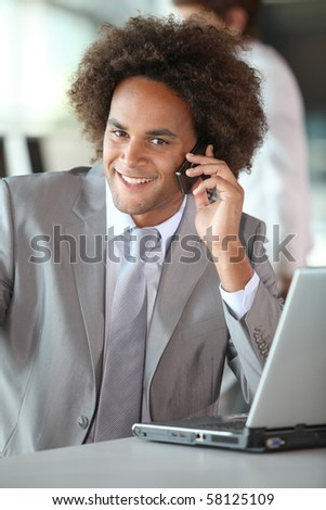 Closeup of happy businessman in the office