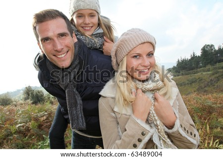Closeup of happy family in fall season