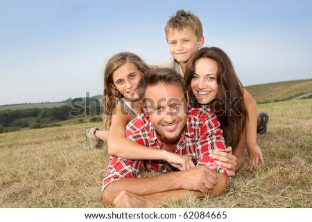 Closeup of happy family lying in grass