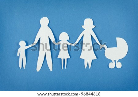 Closeup of happy paper family on blue background - stock photo