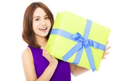 closeup of happy young woman holding a gift box over white background