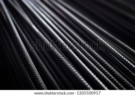 closeup of hard rods division rebars, used on stacked construction concrete background. industrial professional equipment pattern, stiff macro perspective image for reinforcement and construction