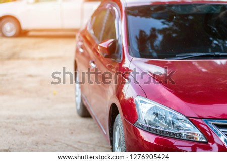 Closeup of headlight ,window of red car outdoors. #1276905424