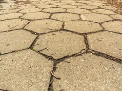 closeup of hexagonal pattern stone sidewalk pavement grey texture background