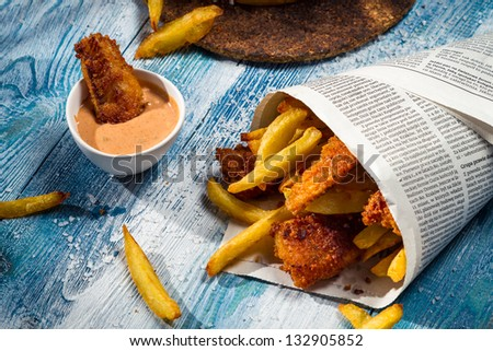 Closeup of homemade Fish & Chips in newspaper