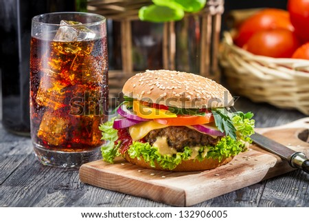 Closeup of homemade hamburger and a Coke with ice