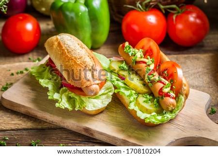 Closeup of homemade hot dog with mustard and ketchup
