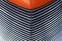 Closeup of hood and Grill of an Orange Custom Hotrod