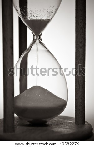 closeup of hourglass in warm black and white