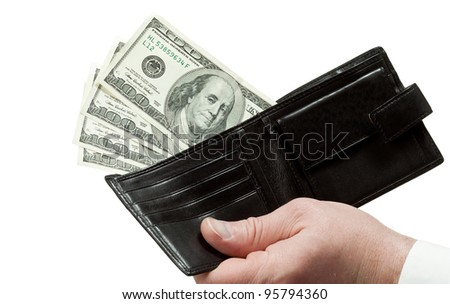 Closeup of human hand holding leather wallet with dollars; isolated over white background