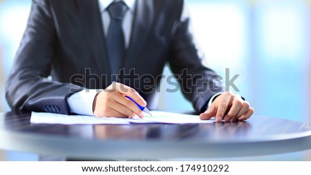 Closeup of human hand writing on a paper. - Shutterstock ID 174910292