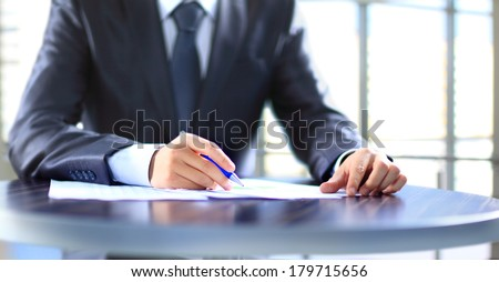 Closeup of human hand writing on a paper. - Shutterstock ID 179715656