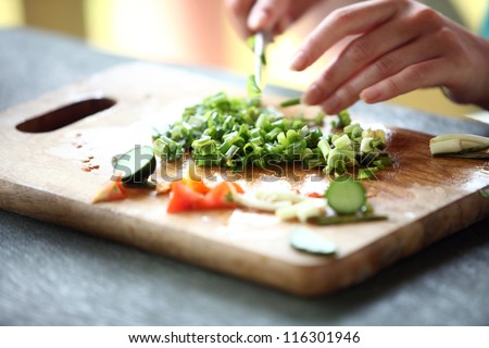 Closeup of Human hands cooking vegetables salad in kitchen