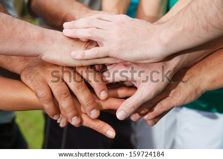 Closeup of human hands showing unity
