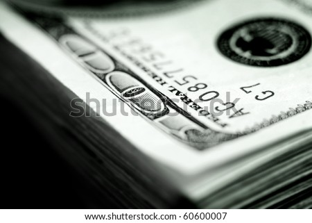 Closeup of hundred dollar bill isolated on white background