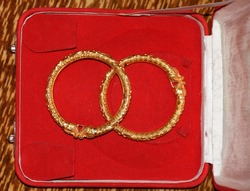 Closeup of Indian traditional Gold bangles or jewellery kept in a jewelry box