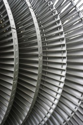 Closeup of industrial turbine rotary blades abstract vertical background pattern