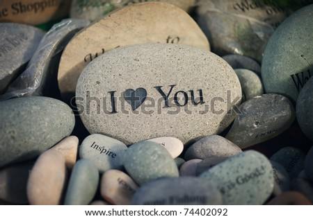 closeup of inspirational message rocks on display in a store