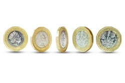 Closeup of Isolated of One Pound sterling coins standing on white background.