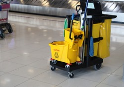 Closeup of janitorial, cleaning equipment and tools for floor cleaning at the airport.