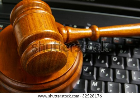 closeup of judges gavel on laptop computer