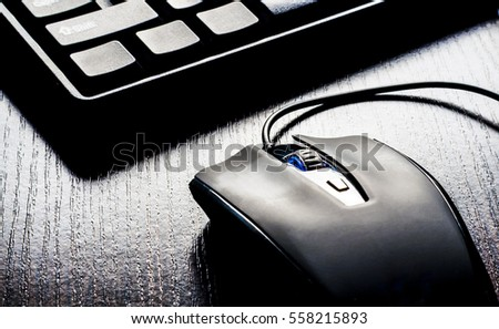 Closeup of keyboard and mouse on black background #558215893