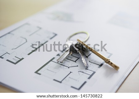 Closeup of keys on blueprint of new home