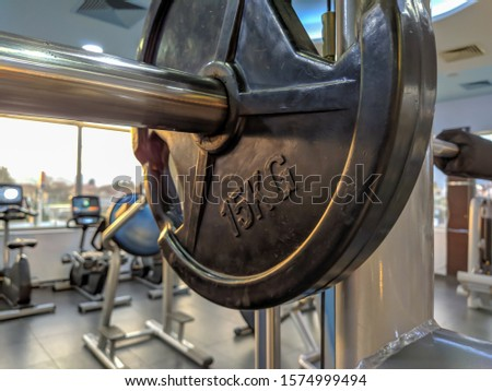 Closeup of 15 kilogram metal steel weight for strength exercise and endurance training for recreation and healthy lifestyle. Getting physical in the gym by bodybuilding