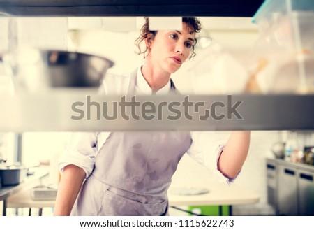 Closeup of kitchen staff prepare cooking ingredients #1115622743