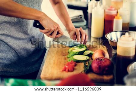 Closeup of kitchen staff prepare cooking ingredients