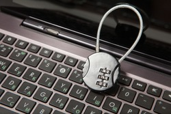 Closeup of laptop with cipher padlock. Information security concept.