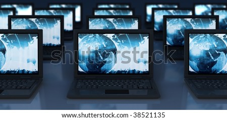 Closeup of Laptops with futuristic world map on the screen with depth of field effect