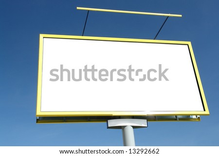 Closeup of large blank billboard waiting for advertisement to be added - against clear blue sky
