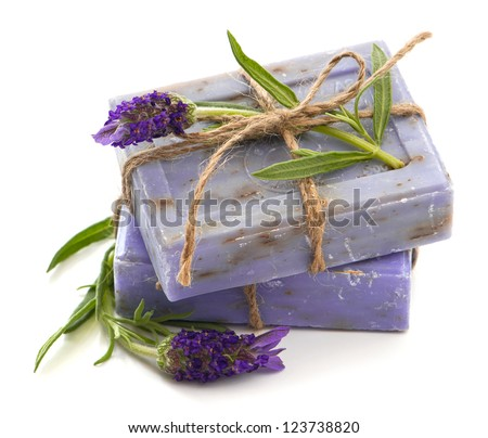closeup of lavender soap bars with fresh blossoms isolated on white background